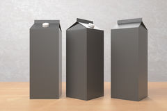 Blank dark milk/juice packagings. Several empty dark carton packagings for milk/juice on light background. Ad concept. Mock up, 3D Rendering Stock Photos