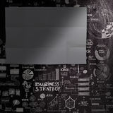Blank dark sheet paperon hand drawn business strategy background Stock Image