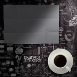 Blank dark sheet paperon hand drawn business strategy background Royalty Free Stock Images