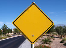 Blank Desert Road Sign. Blank caution sign in a affluent desert community Royalty Free Stock Image