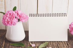 Blank Desk calendar with pink carnation flower Royalty Free Stock Photo