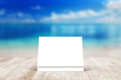 Blank desk calendar on wooden desk. Front view. Mockup template. To replace your design Stock Photos
