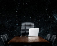 Blank desktop. On a black background. Elements of this image furnished by NASA Royalty Free Stock Photos