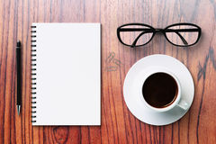Blank diary and coffee cup on a wooden table Stock Photo