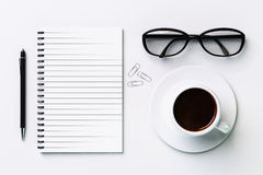 Blank diary, cup of coffee, pen and glasses Stock Image