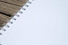 Blank diary on desk. Blank diary on wood desk Royalty Free Stock Photo