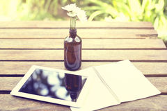 Blank diary with digital tablet and flowers Royalty Free Stock Image