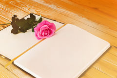 Blank diary note with pink rose in dreamy soft mood colour Royalty Free Stock Photography
