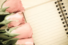 Blank diary note with roses. Royalty Free Stock Photos