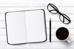 Blank diary with pen and cup of coffee and glasses Stock Photography