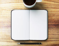 Blank diary with pen and cup of coffee Stock Photography