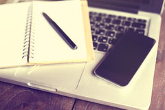 Blank diary with pen, smartphone and laptop Stock Photo