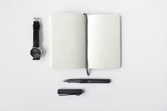 Blank diary, pen, and watch Stock Photo