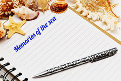 Blank diary with sea shells Royalty Free Stock Image