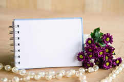 Blank diary and violet flower. Royalty Free Stock Images
