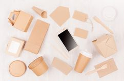 Blank different cardboard packaging for fast food - coffee cup, screen phone, cutlery, sugar, spice, container and box for sushi. Blank different cardboard royalty free stock photography