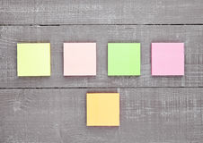 Blank different colors sticky note paper on table Stock Photography