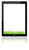 Blank digital PC tablet and  green grass Royalty Free Stock Photos