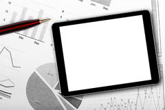 Blank digital tablet on business documents. With variety of charts stock photos