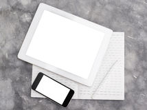 Blank digital tablet, cell phone and diary on a concrete backgro Royalty Free Stock Photo