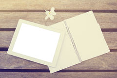 Blank digital tablet and diary on a wooden table Stock Photos