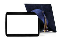 Blank digital tablet and education student cap Royalty Free Stock Photos