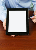 Blank digital tablet in human hands Stock Photos