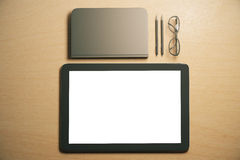 Blank digital tablet screen with diary, pens and eyeglasses on t Royalty Free Stock Photo