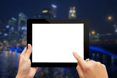 Blank digital tabletp and cityscape Stock Photography