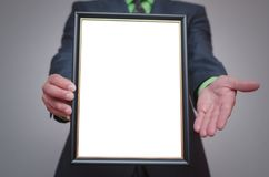 Blank diploma or certificate mockup. Blank diploma or certificate mock up in businessman hand. Empty photo frame border with copy space Stock Photography