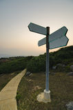Blank Direction Sign at Sunset Stock Photos