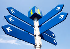 Blank directional road signs. Over blue sky stock images