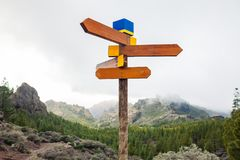Blank directional road signs on mountains background. Choice con. Cept. Travel destination stock image