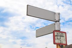 Free Blank Directional Road Signs White Against Blue Sky. Stock Photography - 160957252
