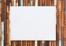 Blank dirty poster paper on old wooden wall Stock Photos
