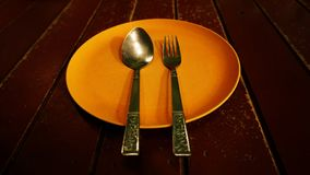 Blank dish and spoon, frok. royalty free stock images