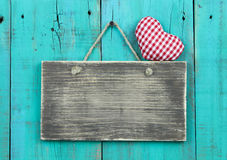 Blank Distressed Wood Sign With Red Checkered Heart Hanging On Rustic Antique Teal Blue Door Royalty Free Stock Photo