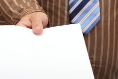 Blank docs in businessman hand Royalty Free Stock Image
