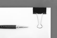 Blank document with paper clip Stock Images