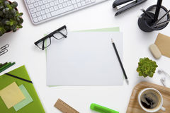 Blank Documents Surrounded By Office Supplies On Desk Royalty Free Stock Photography