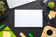 Blank Documents Surrounded By Office Supplies On Gray Desk. Overhead view of blank white documents surrounded by office supplies on gray desk Royalty Free Stock Images