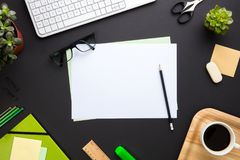 Blank Documents Surrounded By Office Supplies On Gray Desk Stock Photo