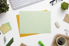 Blank Documents Surrounded With Office Supplies On White Desk Royalty Free Stock Image