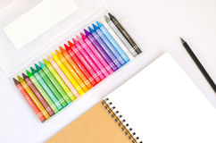 Blank drawing book with black pencil and colorful box set of cra Royalty Free Stock Images