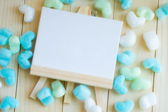 Blank drawing frame and blue green heart surround Royalty Free Stock Image