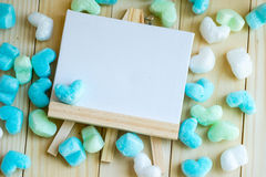 Blank drawing frame and blue green heart surround Royalty Free Stock Images