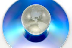Blank DVD with globe on IT Royalty Free Stock Photography