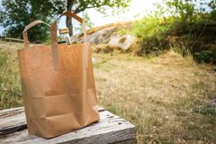 Blank eco paper shopping bag filled with bread and two bottles stock photography