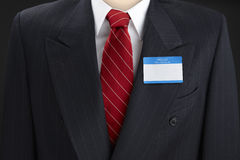 Blank election Pin. Just add your candidate's name to close up of blank election pin shot on blue suit with white shirt and red tie Stock Photo