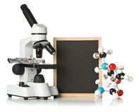 Blank, empty, black chalkboard with microscope, molecule model and DNA model over white royalty free stock images